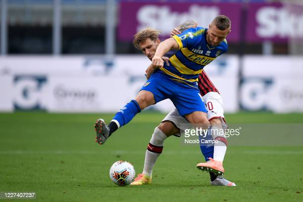 Jasmin Kurtic of Parma Calcio is challenged by Lucas Biglia of AC Milan during the Serie A football match between AC Milan and Parma Calcio. AC Milan...