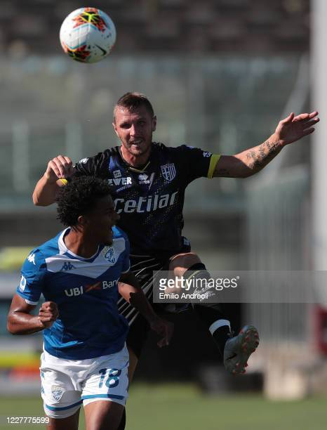 Jasmin Kurtic of Parma Calcio jumps for the ball against Florian Aye of Brescia Calcio during the Serie A match between Brescia Calcio and Parma...