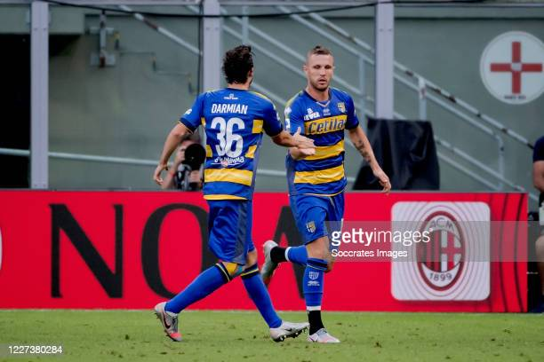 Jasmin Kurtic of Parma celebrates 0-1 with Matteo Darmian of Parma during the Italian Serie A match between AC Milan v Parma on July 15, 2020