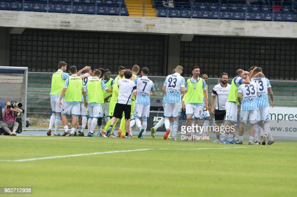 Jasmin Kutric of Spal is mobbed by team mates after scoring his team's third goal during the serie A match between Hellas Verona FC and Spal at...
