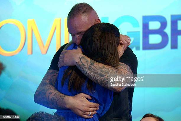 Jasmin Ruehle is hugged by her husband during the final show of Promi Big Brother 2015 at MMC studios on August 28 2015 in Cologne Germany