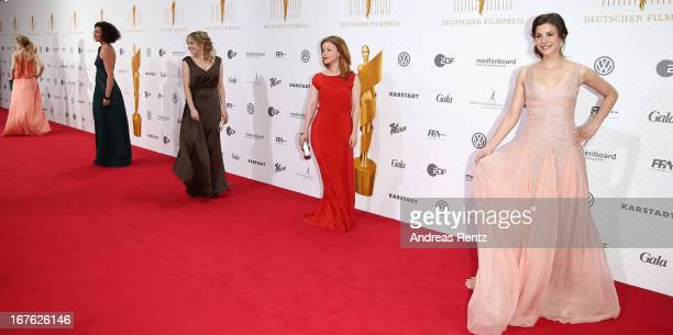 Jasmin Schwiers Karoline Schuch and Aylin Tezel arrive for the Lola German Film Award 2013 at FriedrichstadtPalast on April 26 2013 in Berlin Germany