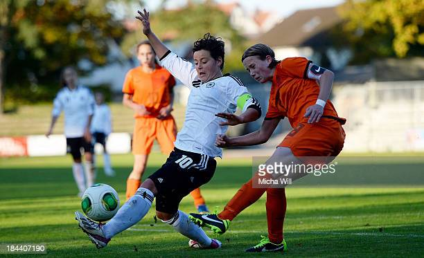 Jasmin Sehan of Germany is challenged by Michelle Hendriks of Netherlands during the U17 Girls Euro Qualifier match between Germany and Netherlands...
