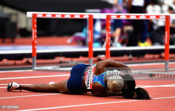 Jasmin Stowers of the United States goes down injured after hitting the last hurdle in the Women's 110m hurdle final during the Muller Anniversary...