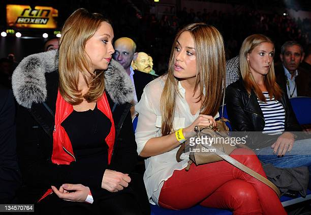 Jasmin Sturm wife of Felix Sturm speaks with Alessandra Pocher prior to the WBA middleweight championship fight between Felix Sturm of Germany and...