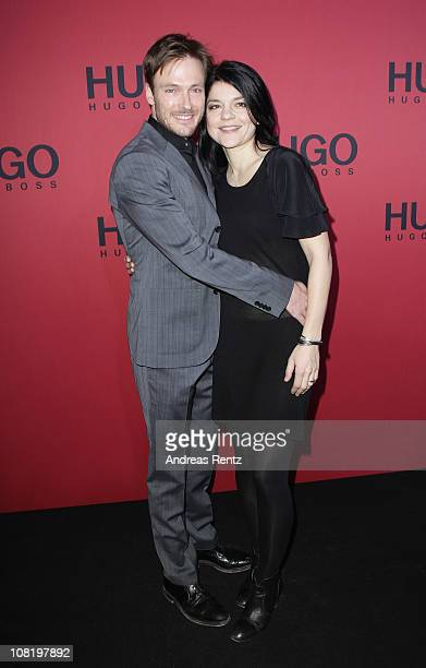 Jasmin Tabatabai and Andreas Pietschmann attend the Hugo Boss Show during the Mercedes Benz Fashion Week Autumn/Winter 2011 at Neue Nationalgalerie...