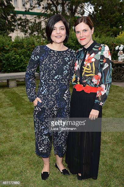 Jasmin Tabatabai and Fritzi Haberlandt attends the Secret Garden Party hosted by Edited at Schinkel Pavillon on June 24 2014 in Berlin Germany