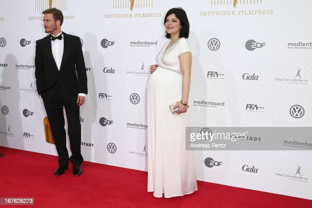 Jasmin Tabatabai and partner Andreas Pietschmann arrive for the Lola German Film Award 2013 at FriedrichstadtPalast on April 26 2013 in Berlin Germany