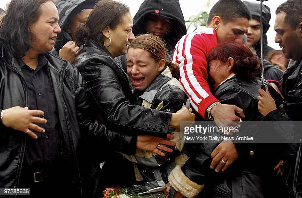Jasmin Villanueva cousin of slain Nixzmary Brown erupts in tears as the young girl's coffin is lowered into a grave at Cyprus Hills Cemetery in...
