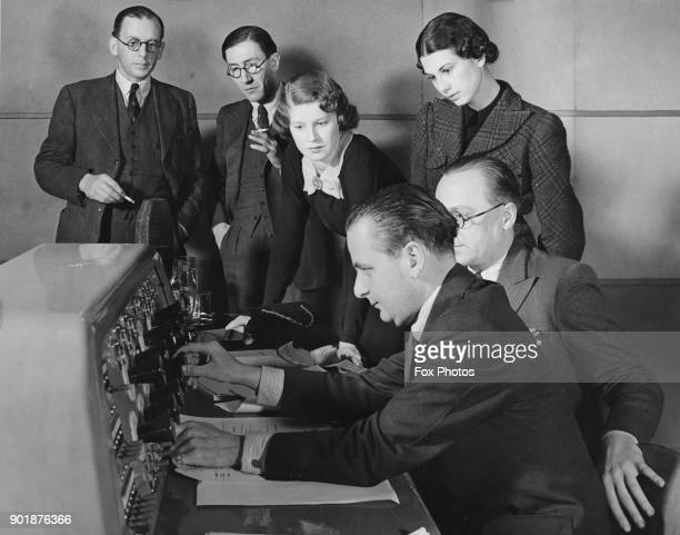 Jasmine Bligh and Elizabeth Cowell the BBC's new announcers learn the workings of the Dramatic Control Panel at Broadcasting House in London 23rd May...