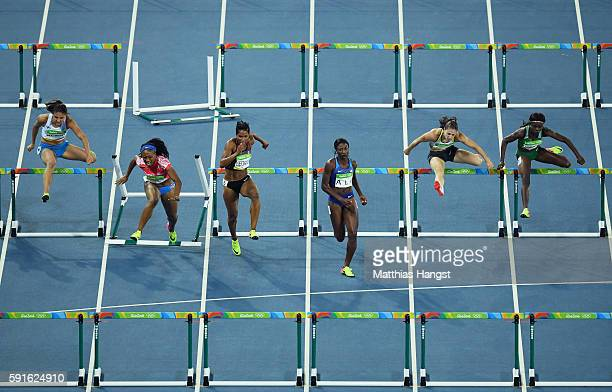 Jasmine CamachoQuinn of Puerto Rico hits a hurdle during the Women's 100m Hurdles Semifinal 2 on Day 12 of the Rio 2016 Olympic Games at the Olympic...