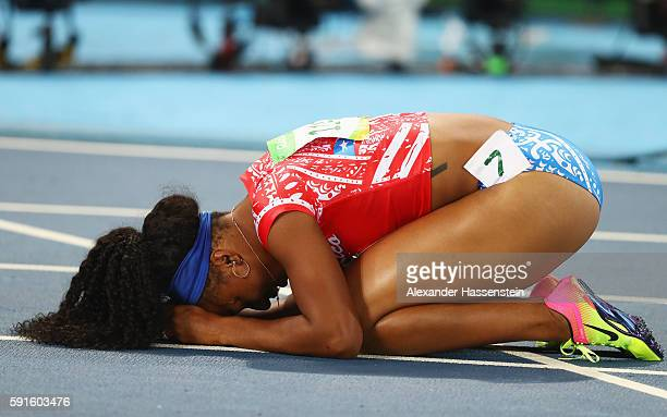 Jasmine CamachoQuinn of Puerto Rico reacts during the Women's 100m Hurdles Semifinals on Day 12 of the Rio 2016 Olympic Games at the Olympic Stadium...