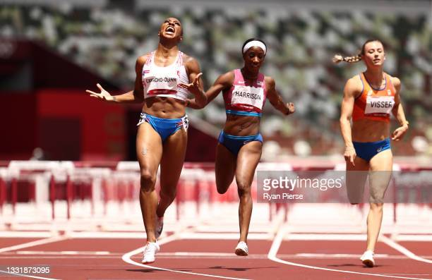 Jasmine Camacho-Quinn of Team Puerto Rico celebrates as she finishes first ahead of Kendra Harrison of Team United States in the Women's 100m Hurdles...