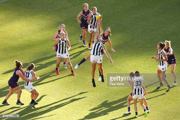 Jasmine Garner of the Magpies and Jodie White of the Dockers contest the ruck during the round two AFLW match between the Fremantle Dockers and the...