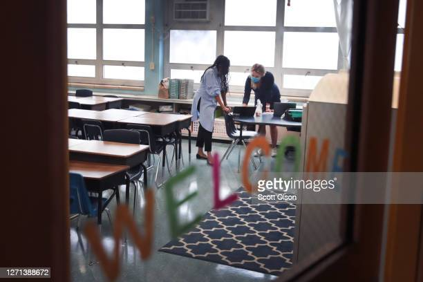 Jasmine Gilliam and Lucy Baldwin, teachers at King Elementary School, prepare to teach their students remotely in empty classrooms during the first...