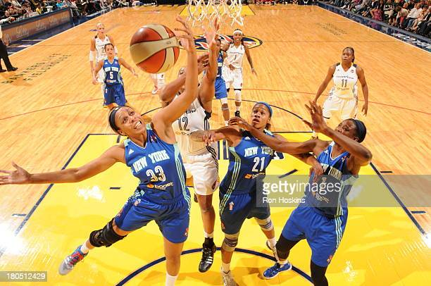 Jasmine Hassell of the Indiana Fever battles Pienette Pierson and Alex Montgomery of the New York Liberty on September 10, 2013 at Bankers Life...