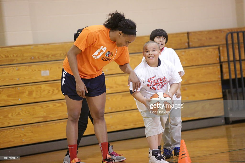 Jasmine Hassell #12 of the Indiana Fever participates in the Indiana Fevers 2014 Fever Cares Tipoff Event, in partnership with the Indy Parks Foundation and Indy Parks on May 14, 2014 at Garfield Park in Indianapolis, Indiana.