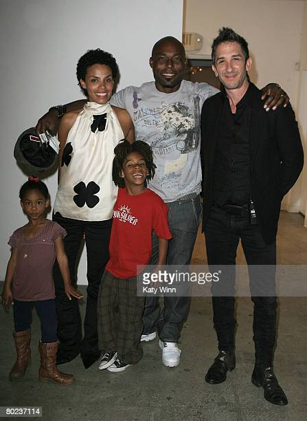 Jasmine JeanLouis Evelyn JeanLouis Thevi JeanLouis actor Jimmy JeanLouis and COO of Smashbox Davis Factor attend MercedesBenz Fashion Week held at...