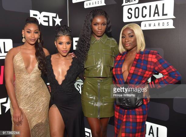 Jasmine Luv Jasmine Brown Leomie Anderson and Sandra Lambeck attend BET Social Awards Red carpet at Tyler Perry Studio on February 11 2018 in Atlanta...