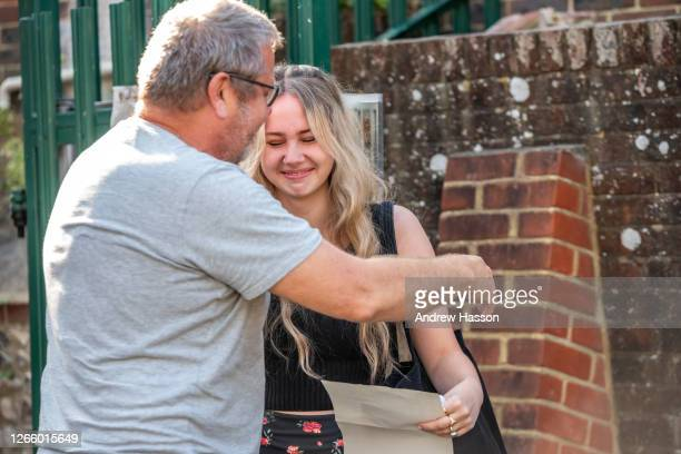 Jasmine Owen-Moulding and her father, Arthur, reacts after receiving her A Level results today at Lewes Old Grammar School on August 13, 2020 in...