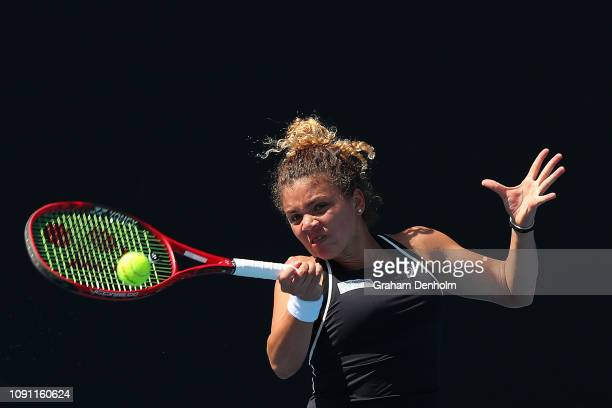 Jasmine Paolini of Italy plays a forehand in her match against Veronika Kudermetova of Russia during day one of Qualifying for the 2019 Australian...