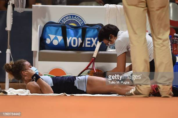 Jasmine Paolini of Italy receives medical attention during her match against Daria Kasatkina of Russia during the 31st Palermo Ladies Open - Day One...