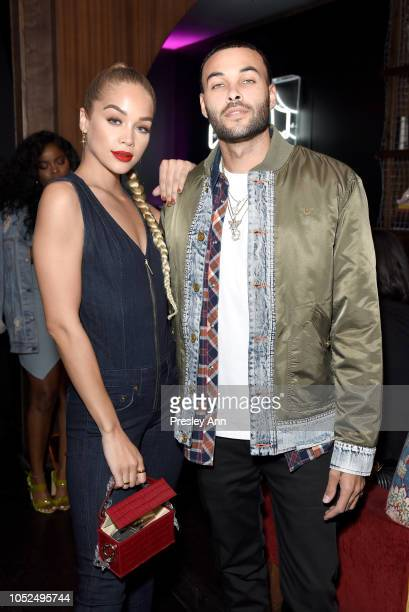 Jasmine Sanders and Don Benjamin attend Bella Hadid x True Religion Event Campaign Party at Poppy on October 18 2018 in Los Angeles California