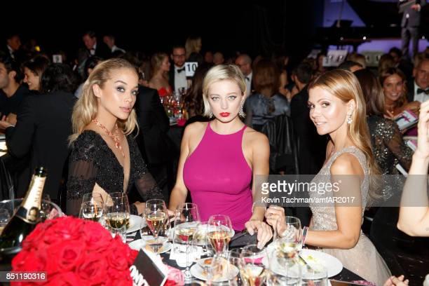 Jasmine Sanders Caroline Vreeland and Elizabeth Sulcer attend the dinner at the amfAR Gala Milano on September 21 2017 in Milan Italy