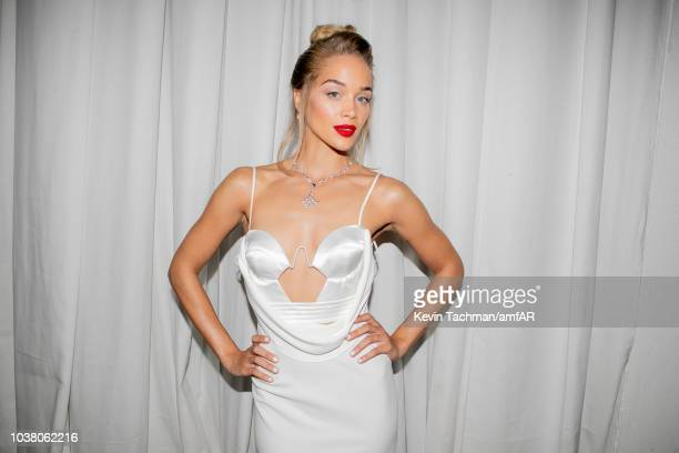 Jasmine Sanders is seen during the cocktail reception of amfAR Gala at La Permanente on September 22 2018 in Milan Italy