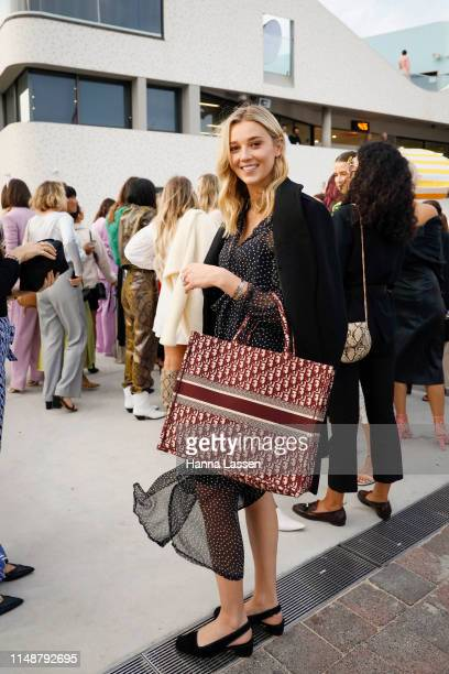 Jasmine Stefanovic wearing dotted dress and Christian Dior bag at Mercedes-Benz Fashion Week Resort 20 Collections on May 13, 2019 in Sydney,...