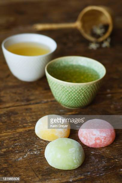 jasmine tea and fruit rice cakes - mochi stock photos and pictures