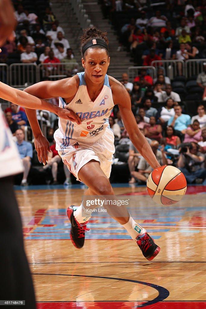 Jasmine Thomas #5 of the Atlanta Dream handles the ball against the Washington Mystics at Philips Arena on July 5, 2014 in Atlanta, Georgia.
