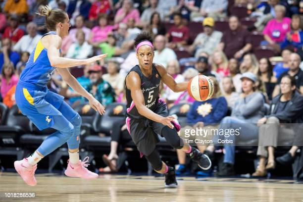Jasmine Thomas of the Connecticut Sun drives past Allie Quigley of the Chicago Sky during the Connecticut Sun Vs Chicago Sky WNBA regular season game...