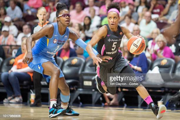 Jasmine Thomas of the Connecticut Sun drives past Diamond DeShields of the Chicago Sky during the Connecticut Sun Vs Chicago Sky WNBA regular season...