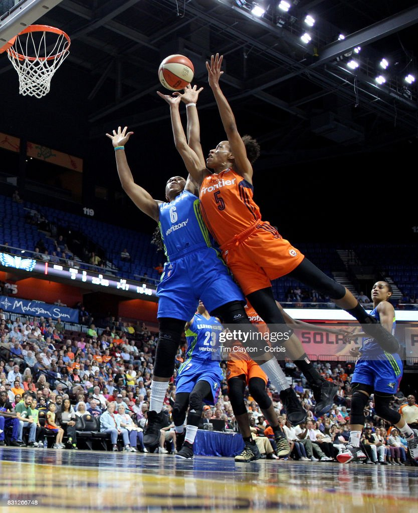 Jasmine Thomas #5 of the Connecticut Sun drives to the basket defended by Kayla Thornton #6 of the Dallas Wings during the Connecticut Sun Vs Dallas Wings, WNBA regular season game at Mohegan Sun Arena on August 12th, 2017 in Uncasville, Connecticut.