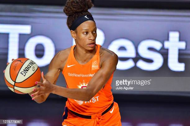 Jasmine Thomas of the Connecticut Sun passes the ball during the second half of Game 2 of their Third Round playoffs against the Las Vegas Aces at...