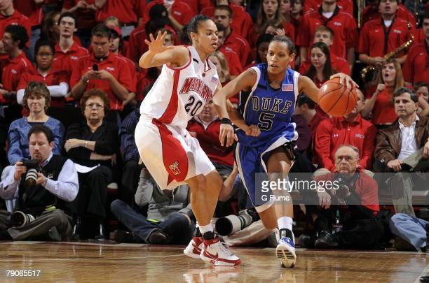 Jasmine Thomas of the Duke Blue Devils handles the ball against Kristi Toliver of the Maryland Terrapins at the Comcast Center on January 14 2008 in...