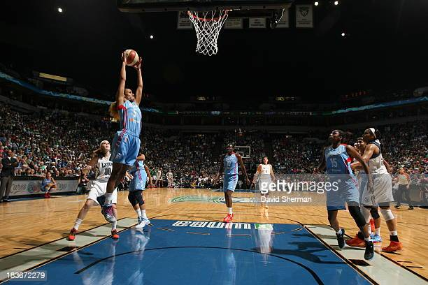 Jasmine Thomas of the the Atlanta Dream grabs the rebound against Lindsey Moore of the Minnesota Lynx during Game 2 of the 2013 WNBA Finals on...