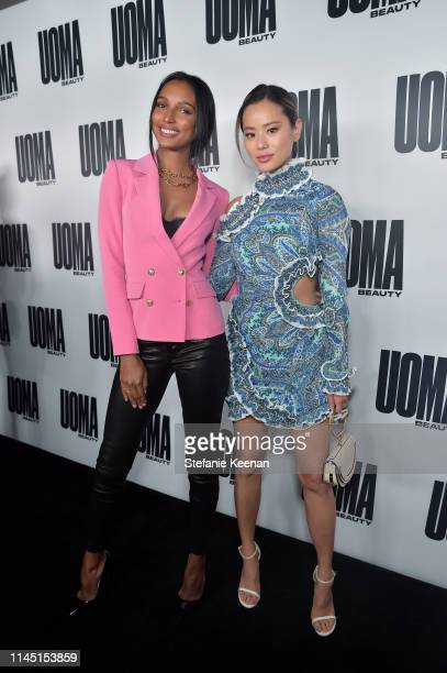 Jasmine Tookes and Jamie Chung attend UOMA Beauty Launch Event at NeueHouse Hollywood on April 25 2019 in Los Angeles California