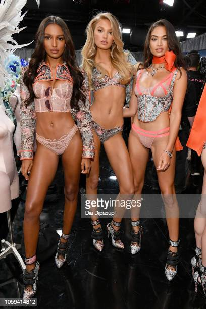 Jasmine Tookes Romee Strij and Shanina Shaik pose backstage during the 2018 Victoria's Secret Fashion Show at Pier 94 on November 8 2018 in New York...