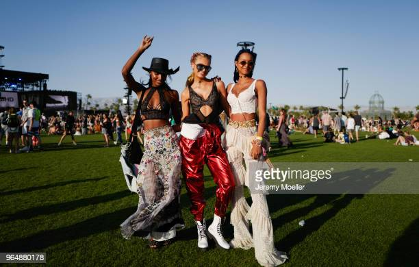 Jasmine Tookes Romeo Strijd and Lais Ribeiro wearing a Victoria Secret BH and Romee wearing a YSL pants during day 1 of the 2018 Coachella Valley...