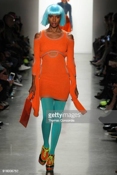 Jasmine Tookes walks the runway wearing Jeremy Scott Fall 2018 with make up by Kabuki for MAC and hair by Eugene Souleiman for Wella at Spring...