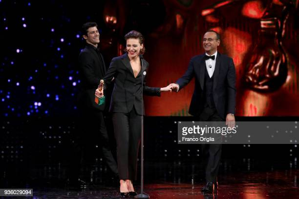 Jasmine Trinca receives the Best Actress Award from Roberto Bolle and Carlo Conti during the 62nd David Di Donatello awards ceremony on March 21 2018...