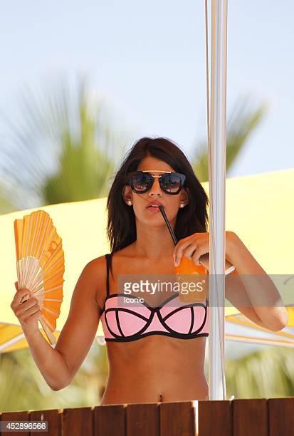 Jasmine Walia is seen celebrating Joey Essex' birthday at the Ocean Beach Club on July 29 2014 in Ibiza Spain