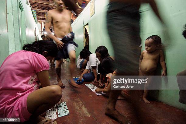 Jasmine watches when her mother and friends plays bingo inside their cell barrack at Manila City Jail. Her father Jaime is a member of Batang City...