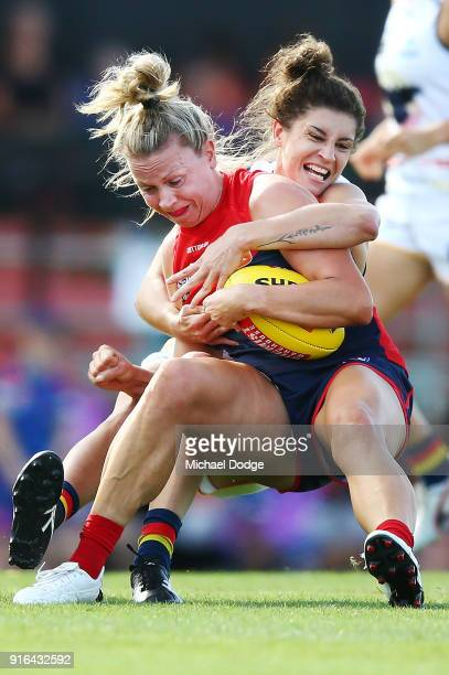 Jasmyn Hewett of the Crows tackles Laura Duryea of the Demons during the round two AFLW match between the Melbourne Demons and the Adelaide Crows at...