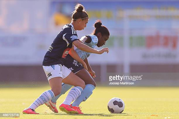 Jasmyne Spencer of Sydney FC competes with Stephanie Catley of the Victory during the round four WLeague match between Sydney and Melbourne at...