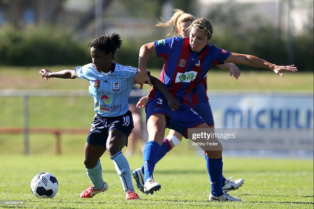 Jasmyne Spencer of Sydney FC contests the ball against Hayley Crawford of the Jets during the round five W-League match between the Newcastle Jets and Sydney FC at Magic Park on October 11, 2014 in Newcastle, Australia.