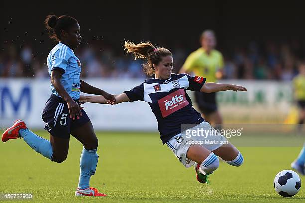 Jasmyne Spencer of Sydney FC is tackled by Lauren Barnes of the Victory during the round four WLeague match between Sydney and Melbourne at Lambert...