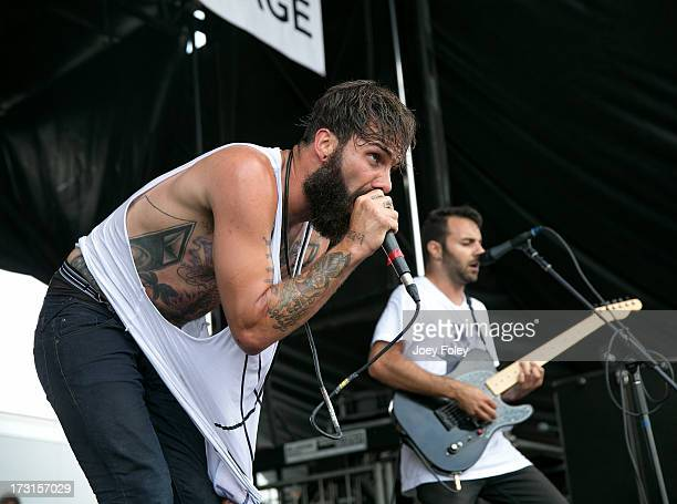 Jason Aalon Butler and Jeff Sahyoun of Letlive performs during the Vans Warped Tour 2013 at Klipsch Music Center on July 3 2013 in Noblesville Indiana